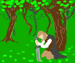 Kneeling in a grove of trees.
