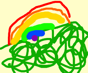 Green hill with a rainbow over it