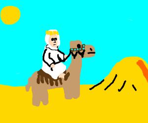 TE Lawrence riding a camel through the desert