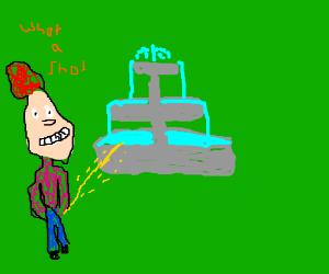 A man peeing in a fountain