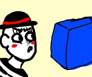 Mime glaring at a blue box