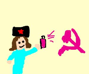 communist girl making pink graffiti