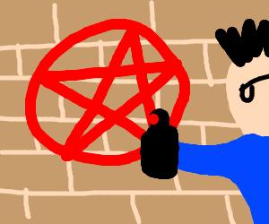man draws pentagram on brick wall