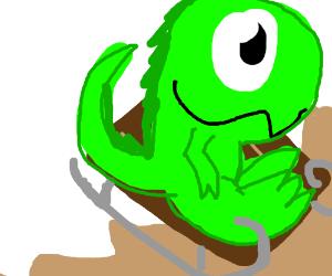 Green dinosaur goes sledding