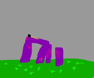 Tape measure atop purple stonehenge