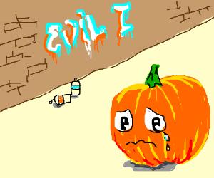 """""""Evil I"""" graffiti upsets orange pumpkin"""