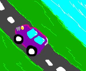 Purple Van drives by river