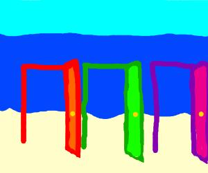 3 doors on a beach lead to the ocean.