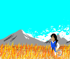 a wheat farm, mountains in background