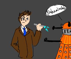 The doctor shines sonic screwdriver in daleks eye
