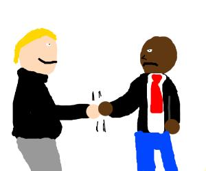businessmen shake on a deal