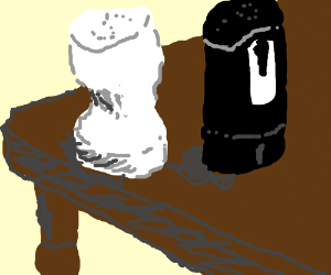 Female salt and male pepper on a table.