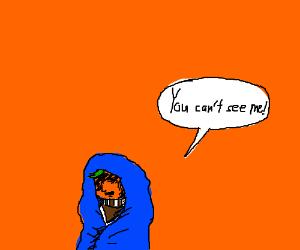 Oompa Loompa hides under a cloak