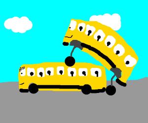2 school buses gettin it on (kids aboard).