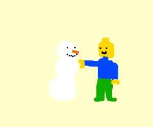 Lego man builds a not lego snowman