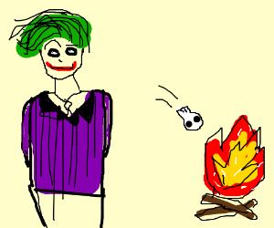 Joker throwing skull into fire