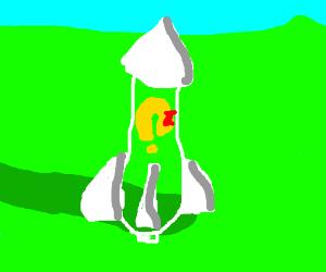 Miss Pac Man on a bottle rocket