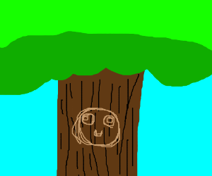 Carving of Rage Guy in a tree