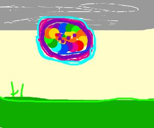 Rainbow ball over gray sky