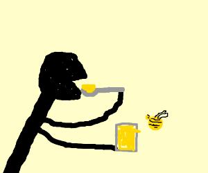 Guy eats honey