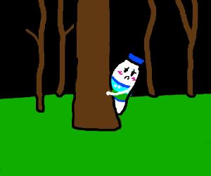 Shy Milk is standing behind tree