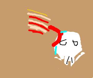 lasagne licking a skull