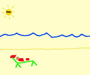Santa is tanning at the beach