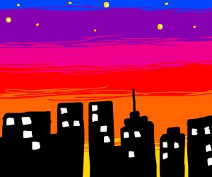 Sun sets behind a cities skyline.