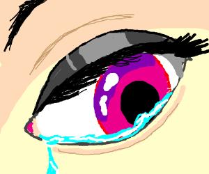 A pink irised eye shedding a tear.