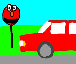 Car man stops at elmo warning sign