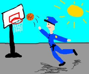 cop plays basketball