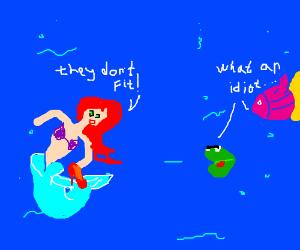 Ariel tries to wear red pumps.  Sealife mocks.