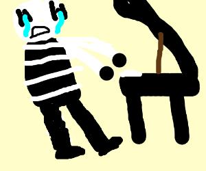 Mime cries while playin piano