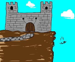A large castle by cliffside
