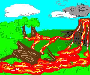Fresh lava flows over trees