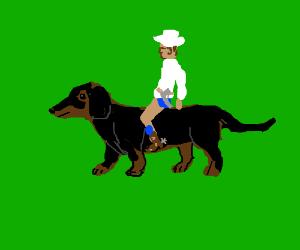 Cowboy riding a dachshund