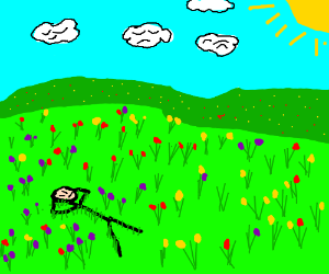 Rick is laying in a field of flowers