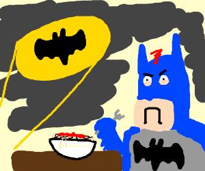 Bat Signal interrupts Batman's spaghetti.