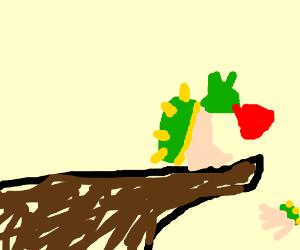 Bowser shoves bowser jr. off a cliff