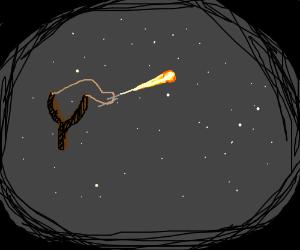 a slingshot shooting a star