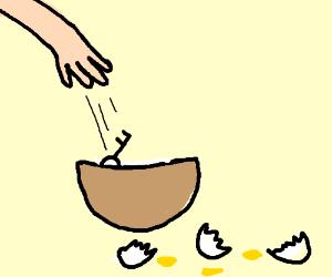 Key dropped into bowl of whipped egg whites