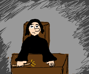 Snape sitting at his desk with wand in hand