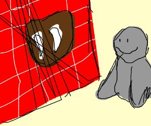 Grey Walrus puts his fangs on brick wall