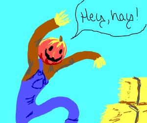 Scarecrow w/ pumpkin head sees hay