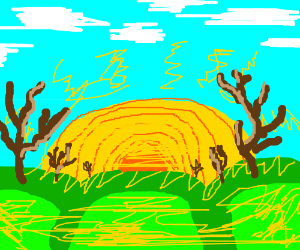 Sun rising over grassy hills