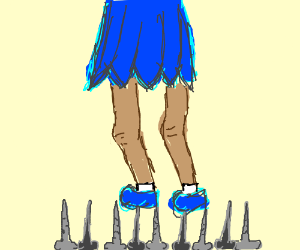 girl in blue skirt walks on bed of nails