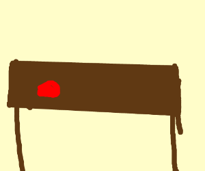Red lump on a table