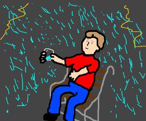 Man sitting in the rain, gathering it in a jar