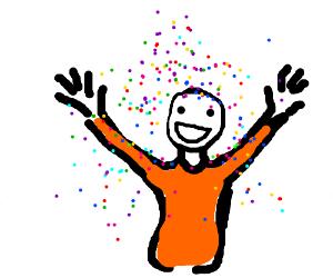 man in orange shirt in a shower of confetti
