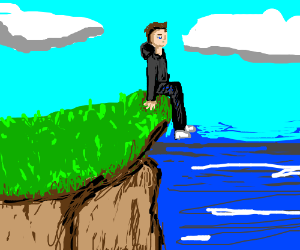 Man sits on a cliff by the sea
